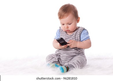 Sweet small baby with mobile phone on a white background.