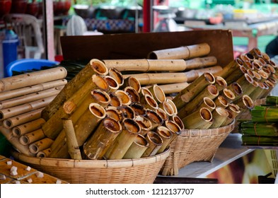 Sweet snack thai style Khao Lam or Glutinous sticky rice soaked in coconut milk and roasted baked in bamboo stem for sale at local shop at Ang Sila seafood Market in Chonburi, Thailand
