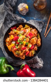 Sweet and sour chicken with colorful bell pepper on a plate. Chinese dish
