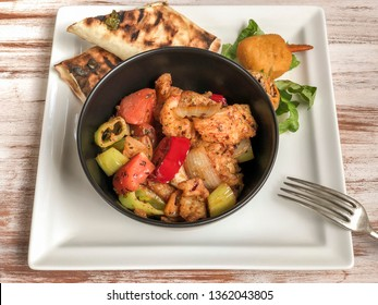 sweet and sour chicken on table