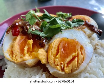 Sweet and sour eggs Rice topped in a plate.