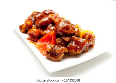 sweet and sour pork, a chinese take out food with pineapple and peppers