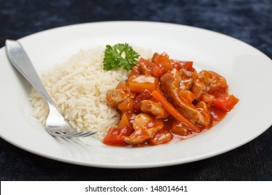 Sweet and sour pork meat with rice