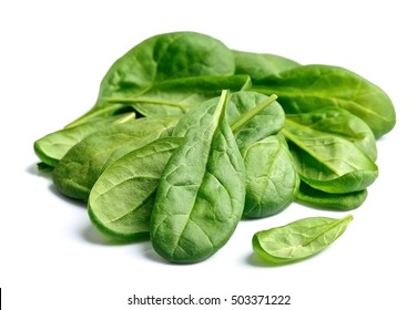 Sweet spinach close up isolated on white.