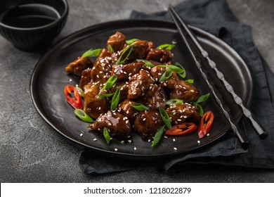 sweet sticky pork served with chives and  sesame seeds, selective focus