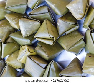 Sweet sticky rice in banana leaf package