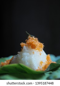 Sweet sticky rice with shrimp topping on pandan leaf. Traditional Thai dessert.