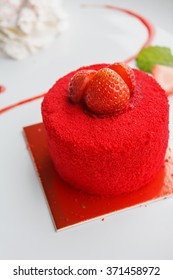 sweet strawberry cake on white plate