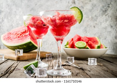 Sweet summer watermelon and lime granita with sliced watermelon and mint, on white marble background copy space