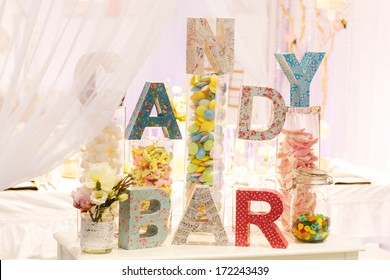 Sweet table as candy bar with different sweets on dinner or event party