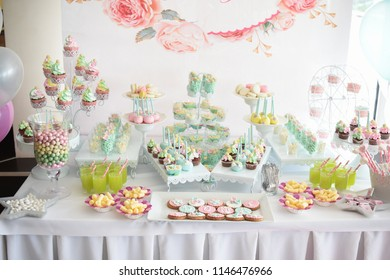 Sweet table for child birthday. Candy bar with a lot of different candies and sweet cakes