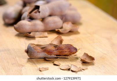Sweet tamarind on Chopping Wood  background Thai fruits / Blurred and Select focus