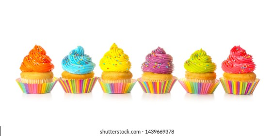 Sweet tasty cupcakes on white background