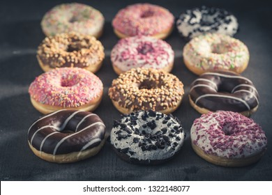 Sweet and tasty donuts with different sprinkles