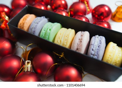 Sweet and tasty french dessert macarons with Christmas decoration