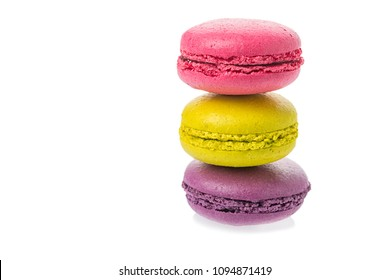 Sweet tasty macaroons on eath other isolated on a white background
