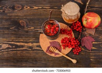 Sweet tea from berries of viburnum. Herbal tea. Traditional medicine.