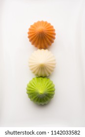 Sweet Tiranga coloured modak shape mithai or dumpling for Independence or republic day greeting card