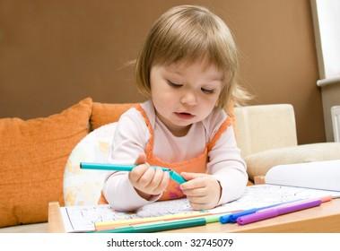 sweet toddler baby girl drawing