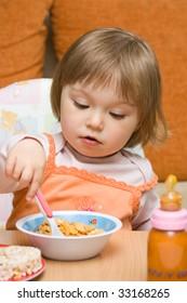 sweet toddler baby girl eating