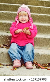 sweet toddler girl in fall time