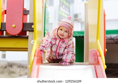 sweet toddler girl on the playground