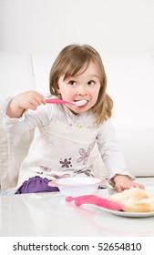sweet toddler little girl eating