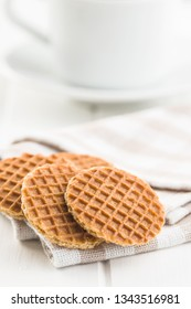 Sweet waffle biscuits on checkered napkin.