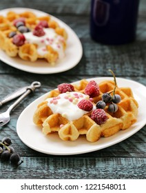 sweet waffles with berries for breakfast