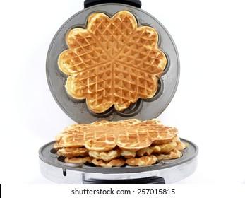 sweet waffles into the iron waffles maker