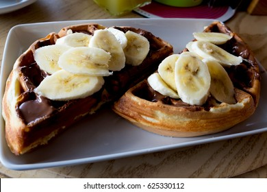 Sweet waffles with nutella cream and banana slices