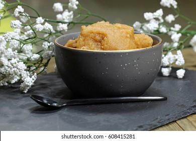 Sweet whole wheat halwa or porridge on a dark background, selective focus.