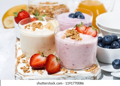 sweet yoghurts with fruits and berries for breakfast, closeup