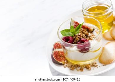 sweet yogurt with honey and fresh figs on white background, horizontal