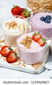 sweet yogurts with fruit and berries for a delicious breakfast, top view