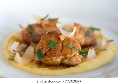Sweetbread with bacon, lemon puree, cippolini onions and tarragon is shown.