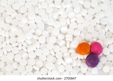 Sweetener texture or background with three candies, low calorie