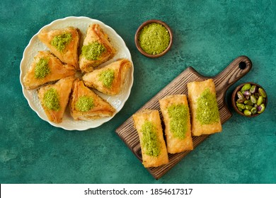 Sweets arabic dessert baklava, , kunafa, kadayif with pistachio and cheese . Top view