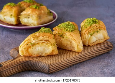 Sweets arabic dessert kunefe, kunafa, knafeh with pistachio and cheese