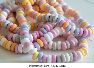 sweets Beads and bracelets candy on a white background