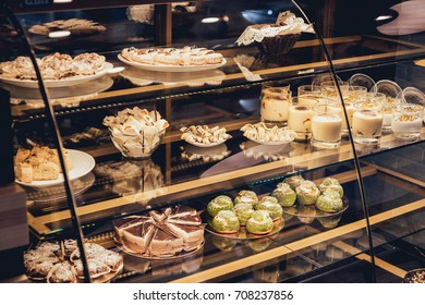 Sweets and cakes in showcase. Italian pastry shop. Cakes with fruits, berries and chokolate. Restaurant