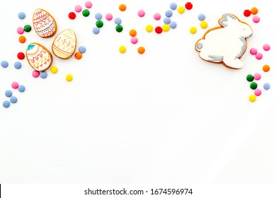 Sweets for celebrate Easter.  Gingerbread in shape of easter bunny,easter eggs and carrot .  White background top view mockup