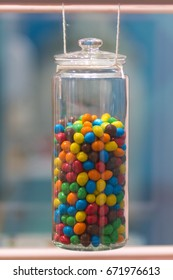 Sweets in a glass jar of candy.