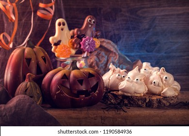Sweets for halloween party on a wooden background
