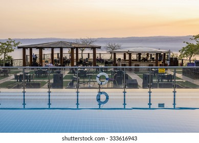 Sweimeh, Jordan - April 07, 2015: View of sunset over death sea from Horizon Terrace at Holiday Inn Resort Dead Sea. This outdoor bar and restaurant is a relaxed spot at any time of day.