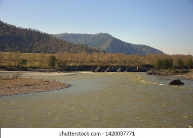 The swift Katun River carries its turquoise waters along the foot of the Altai Mountains. Gorny Altai, Siberia, Russia.