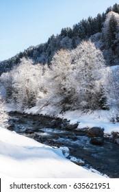 Swift river in winter, Austria