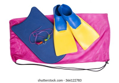 Swim fins, kick board and goggles on a pink swim bag, isolated white background for high school swim team background or competitive swim teams.