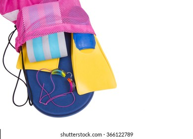 Swim fins, kick board, pull buoy and goggles spilling out of a bag on a isolated white background for high school swim team background or competitive swim teams. Top view.