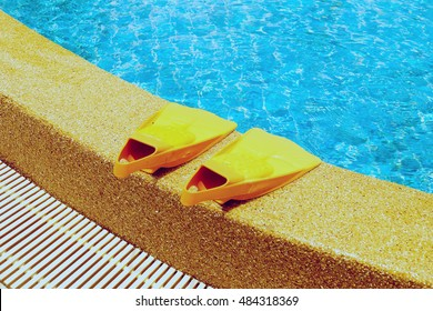 Swim flippers at swimming pool .